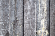The Fence Is Made Of Gray Wooden Planks. Background Texture