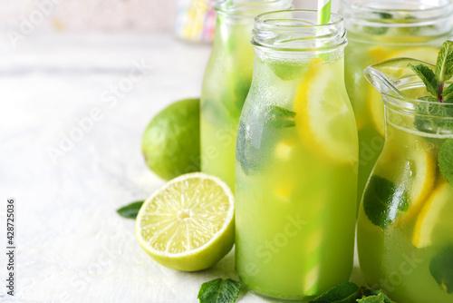 Fototapeta Mint lemonade with lemon and lime