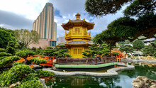 Chinese Asian Buddhism Temple With Buddha And Buddhist Statues, Shrines, Pagodas, Altar Offerings And Burning Incenses In Red And Gold Decor Religious Spiritual Surrounding In Public Park Landscape