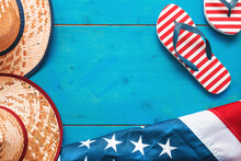 Summer In America, Top View Flat Lay Of USA Flag, Flip Flops And Sonoma Straw Beach Hat