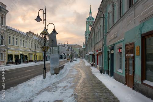 View of the Pyatnitskaya street on a frosty winter morning after heavy snow. - fototapety na wymiar