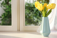Beautiful Fresh Yellow Tulips On Window Sill Indoors. Spring Flowers