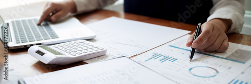 Financial inspector calculating a numbers in office room.. Fototapet