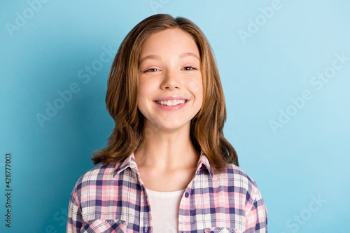 Photo of funny funky small girl wear checkered shirt smiling isolated blue color background - fototapety na wymiar