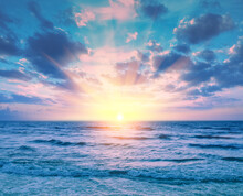 Beautiful Sunset Over The Sea. Seascape With Calm Sea And Cloudy Sky