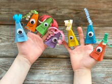 Cute Monsters On Children's Hand, Kids DIY From Recycling Egg Box.