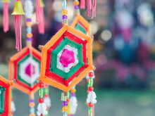 Colorful Decorative Mobile Spider Web Weaving Hanging On A Tree. Crafting Colorful Yarn To Use Decorations For Festivals. Space For Text