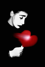 Pantomime. Sad Mime Performer With Ripped Broken Heart