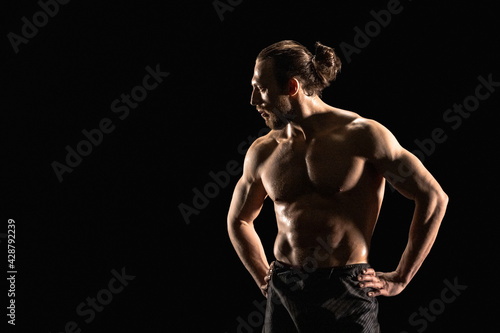 Fotografie, Obraz Portrait of athletic man on black background