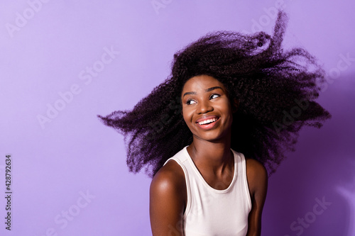 Portrait of attractive cheerful dreamy girl air blowing hair good mood isolated over bright violet purple color background - fototapety na wymiar