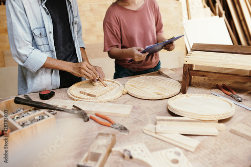 Obraz Team of carpenters making round wooden cutting boards for customer - fototapety do salonu