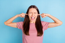 Photo Of Unhappy Upset Crazy Annoyed Young Woman Cover Ears Fingers Isolated On Pastel Blue Color Background
