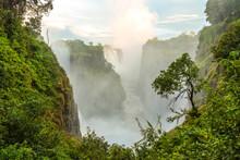 Victoria Falls, The Zambezi River Waterfalls Viewed From The Cliffs Of Zimbabwe