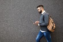 Businessman Walking In Street Holding His Laptop, Working Outdoor
