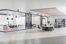 Spacious Sunny Office Hall With Wooden Decoration And Workplaces And Confrence Rooms Behind Glass Walls