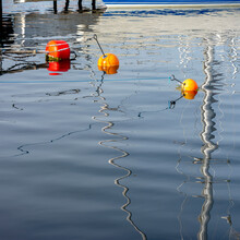 Floating Red And Orange Water Buoys
