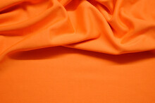 Orange Textile Pattern As A Background. Orange Material Texture On Fabric