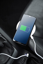 Mobile Phone ,smartphone, Cellphone Is Charged ,charge Battery With Usb Charger In The Inside Of Car. Modern Black Car Interior