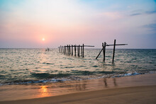 Sunset Over The Beach And Ruin Pier