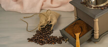 Coffee Beans And Ground Coffee With Grinder And Raffia Fabrics