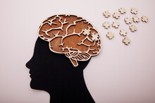 Head Of Man With Brain And Wooden Puzzle. Alzheimer's Disease, Dementia And Mental Health Concept