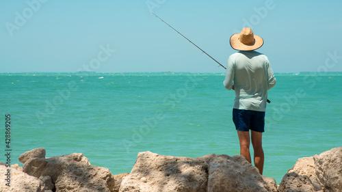 Fotografija Fisherman with fishing rod
