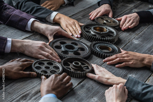 Business people connect gear
