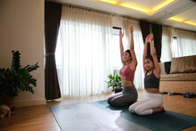 Happy And Healthy Family Concept, Mother And Daughter Learn And Practice Fitness And Yoga Folling Online Course