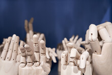 Dummy Model Wooden Human Hands Gesture Set On Shelf On Blue Background Close Up. Mannequin Hand Collection Closeup. Copy Space