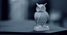 Blue Owl Object Printed By 3d Printer Stands On Blurry Dark Background