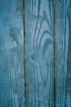Upright Wooden Planks Painted Blue With Antiqued Craquelure