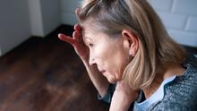 Desperate Lonely Elderly Woman Having A Headache. High Quality Photo
