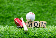 Baseball With Word Mom For Mother's Day Are On Green Grass