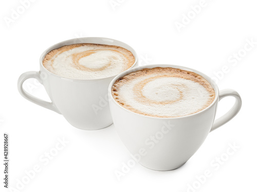 Tela Cups of hot cappuccino coffee on white background