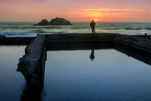 A Man Standing On Ruins Of Sutro Baths And Watching The Sunset. San Francisco, California, USA.