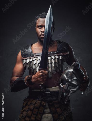 Papel de parede Studio shot of antique roman gladiator of african ethnic with sword