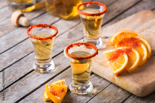 Obraz na plátně Mexican mezcal or mescal shot with chili pepper and orange