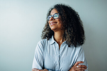 Mature businesswoman looking away and smiling