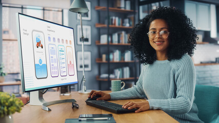 Latina Female Specialist Working on Desktop Computer at Home Living Room while Sitting at a Table. Freelancer Developing New Food Delivery App Design, User interface in a Graphics Editing Software.
