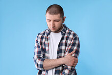 Upset Man In Shirt On Light Blue Background