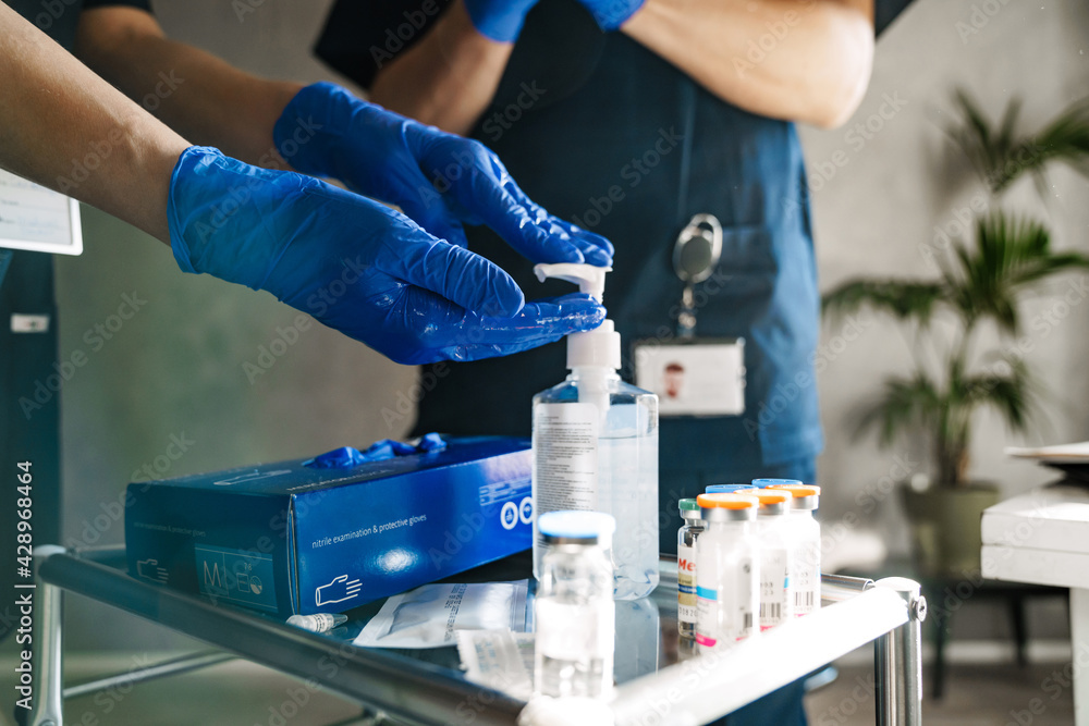 Fototapeta Close up of two doctors sterilizing hands before surgery