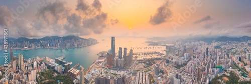 Epic aerial view of evening scene of Victoria Harbour, Hong Kong, in golden hour