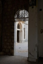 Arch Entrance With Ornate To An Old Ruined Palace Hotel In Lebanon