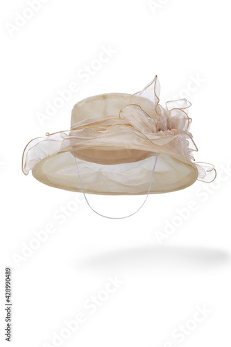 Tablou Canvas Subject shot of beige organza hat with chin strap and decorated with large tissue flower