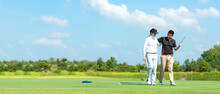 Group Golf Playing. Professional Golfer Asian Man Walking And Hug For Friendship After Finish Put Golf Ball On Green. Hobby Relax In Holiday And Vacation With Friends.  Copy Space For Banner