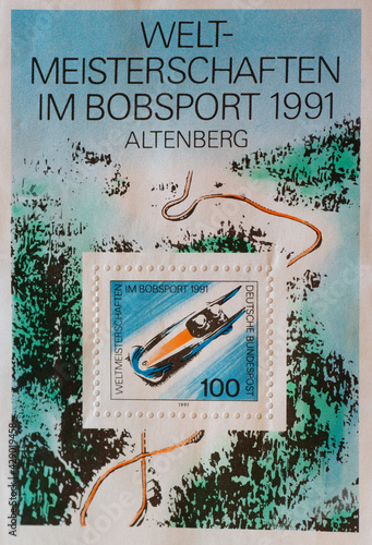 Photo GERMANY - CIRCA 1991 : a postage stamp from Germany, showing a two-man bobsleigh at world bobsleigh championships in Altenberg