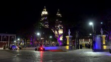 Tiny Police Patrol Car With  Flashing Lights At The Independence Plaza By Night. San Francisco De Campeche, Mexico