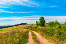 Dirt Road On A Hill In The Meadows On A Sunny Summer Day