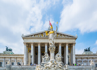 View of the statue of Pallas Athena situated in front of the parliament building in Vienna, Austria.