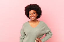Afro Black Woman Smiling Happily With A Hand On Hip And Confident, Positive, Proud And Friendly Attitude